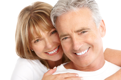Smiling Couple after getting cosmetic dentistry treatment by their dentist at Everwell Dentistry, Ann Arbor Dentist.
